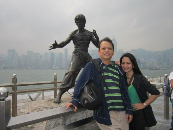 Oca and the love of his life Mari.  Is that Bruce Lee's statue in the background? :)