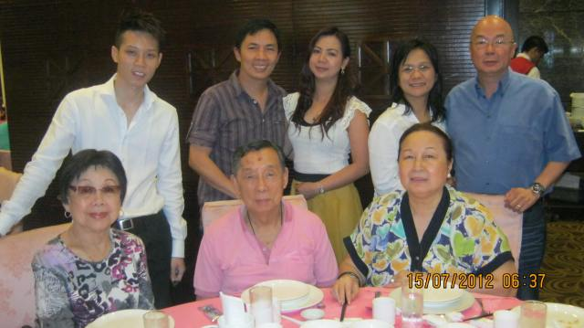 ...and a more recent pic with Dad (center, seated) Mom (to his left), Tita Lily (to his right), my brother Tim and his wife Joy (standing, extreme right) and Mahal (the stunner with the long hair)