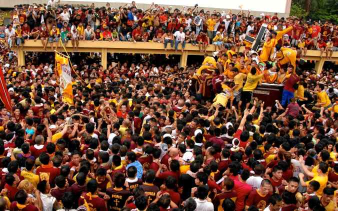 Quiapo, Manila procession during the Feast of the Black Nazarene, thought to earn forgiveness of sin for all participants.