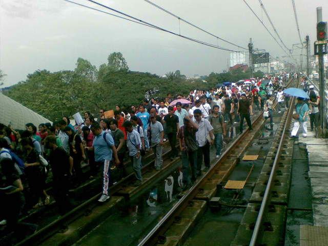 no, these MRT passengers did not miss their ride.  They are walking on the tracks from an MRT car that broke down.  Looks dangerous no?  thanks to bulatlat.com for the photo!