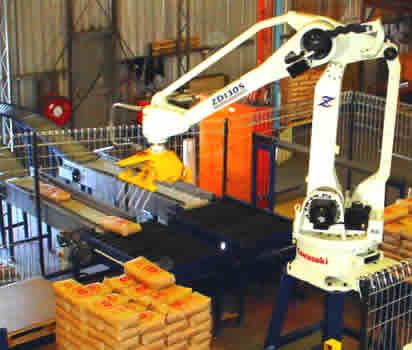 This is what the robot palletizer looks like.  Ours has a cage around it, because you don't want to be ANYWHERE near it when it's working;  one hit and you're a goner. :(