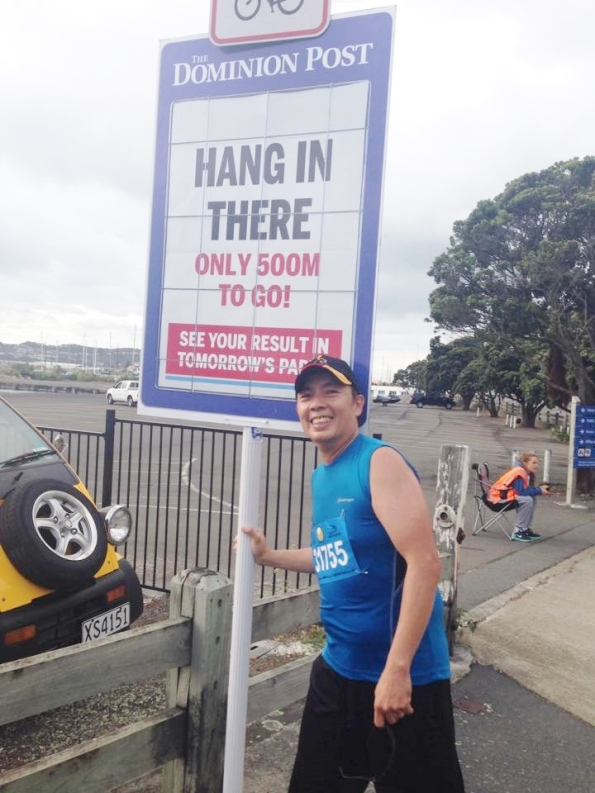 I can't believe while everyone was huffing and puffing I posed for a selfie during the half-marathon.  the sign btw  is for participants of a much shorter 10k event, which shared part of the route with the half-marathoners.  Thanks for all the encouragement!